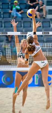 world championships: ROME, ITALY - JUNE 15 2011. Beach volleyball world championships. Italian player Marta Menegatti and england player Denise Johns during a match