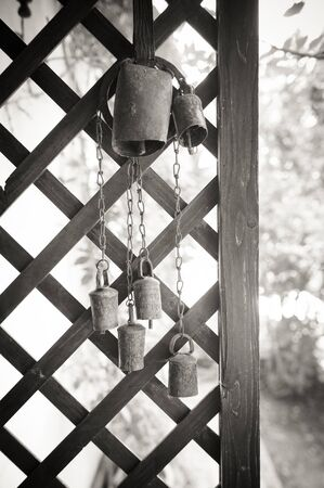 tarnished: Old cow bell decoration black and white in rural house