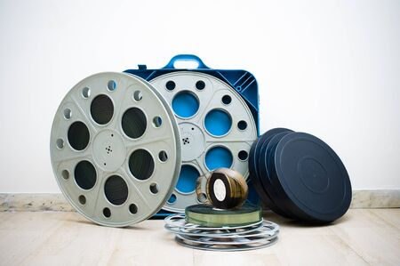 35 mm: Heap of old 35 mm cinema movie reels with blue professional boxes