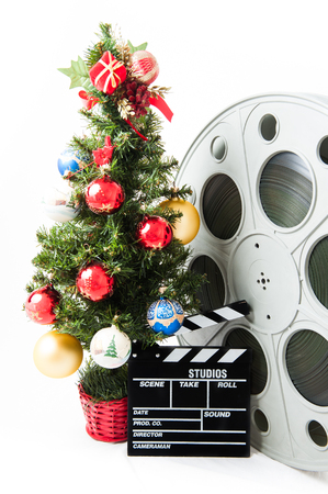 clapperboard: Christmas tree with big movie reel and clapperboard