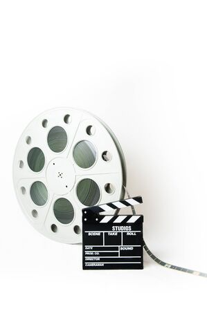 35: Big movie reel and 35 mm film Stock Photo