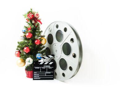 cinta pelicula: Árbol de navidad con gran rollo de película y claqueta
