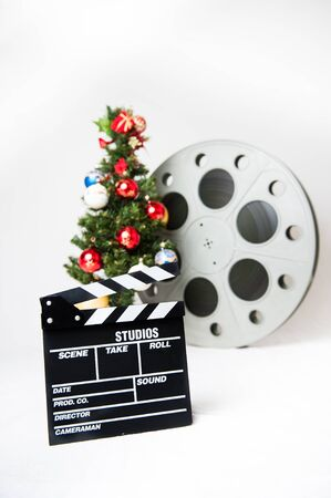 christmas movies: Movie clapper board with christmas tree and reel