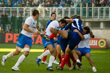 nations: ROME, ITALY - FEBRUARY 3 2007.  Rugby six nations cup Italy-France. Players in action scrum on playground