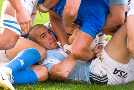 scrum: ROME, ITALY - NOVEMBER 18 2006. Rugby test match Italy-Argentina. Scrum action during match, close up