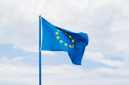 european community: European community flag in cloudy sky