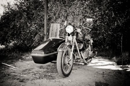 sidecar: Otranto, Italy - September 12 2015. Jawa 350 sidecar clean and shiny parked. Black and white Editorial