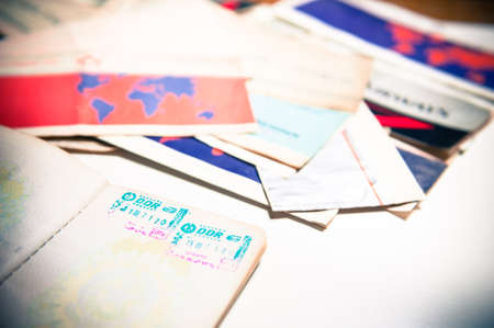 passeport: Ancien passeport Allemagne de l'Est avec timbre et billets d'avion de mise au point en arri�re-plan Banque d'images