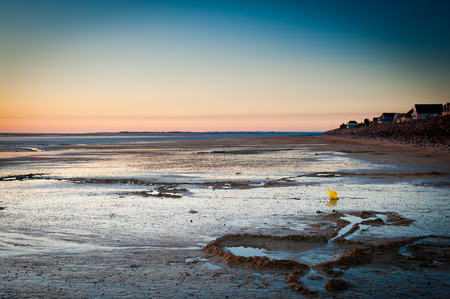 normandy: Scenic sunset landscape on a Normandy beach during low tide