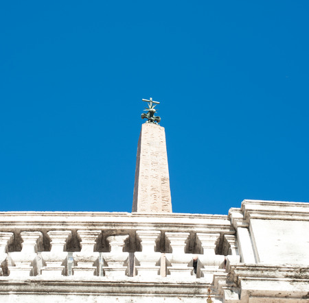 Spagna: Egyptian obelisk Sallustiano in Piazza di Spagna in Rome on blue sky and clouds Stock Photo
