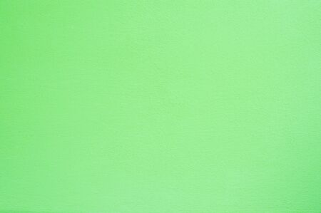 uneven: Light green rough concrete wall surface, seamless uneven abstract background