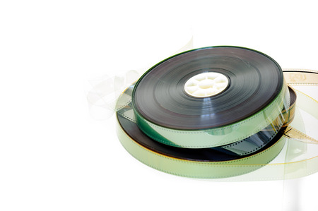 35 mm: 35 mm movie reels with copy space isolated on white background