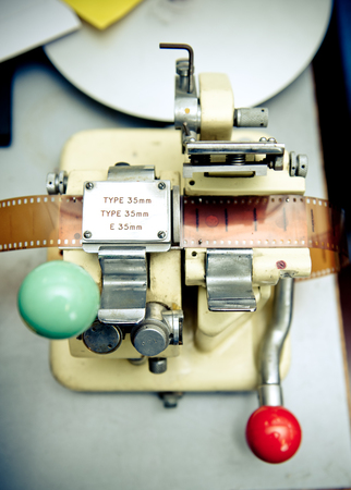 35 mm: Old 35 mm movie splicer for editing close up, vintage movie post production