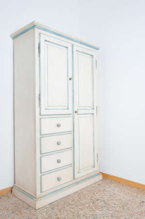 vintage furniture: Vintage white armoir furniture in house on marble floor