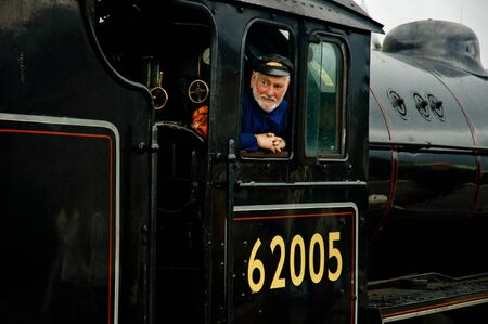 Fort William, Scotland -  August 17 2005. Old steam train The Jacobite locomotive with train conductor Editorial