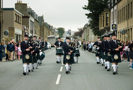 gaita: Thurso, Scotland -  August 13 2005. Scottish traditional bagpipes marching band on the street