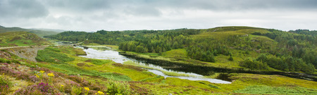 highland: Scenic view of lake and road on green highlands in Scotland Stock Photo