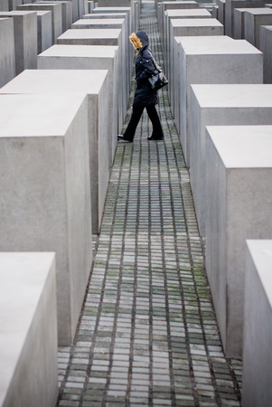 murdered: Berlin, Germany - December 30 2006. One person walking between stones of Memorial of murdered jews during second world war