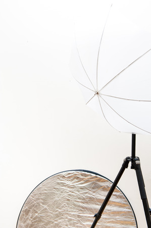 reflector: Studio photography equipment part, with silver reflector and white umbrella Stock Photo