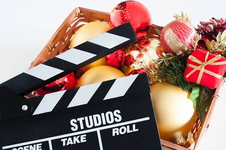 christmas movies: Movie clapper board and christmas decoration red and golden on white background