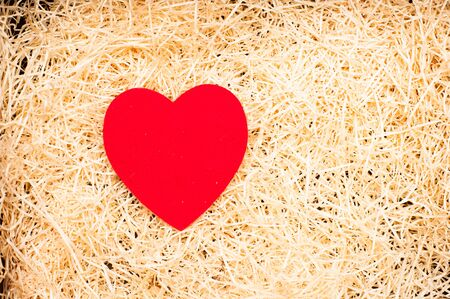 cradle: Love cradle with red heart on yellow straw carpet