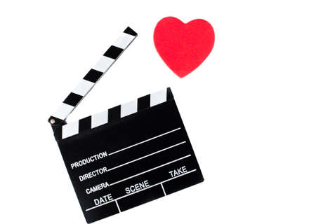 holiday movies: Movie clapper board and red heart isolated on white background