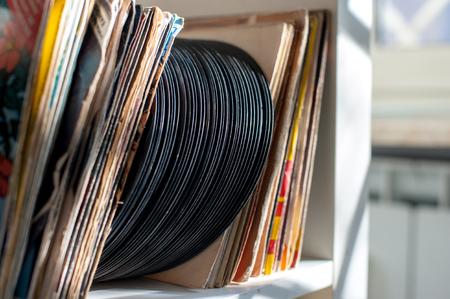 row house: Vintage 45s vinyl row house on shelf selective focus Stock Photo