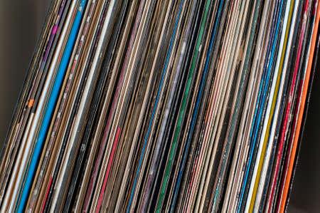 lp: 33 colorful vintage vynil LP covers on shelf