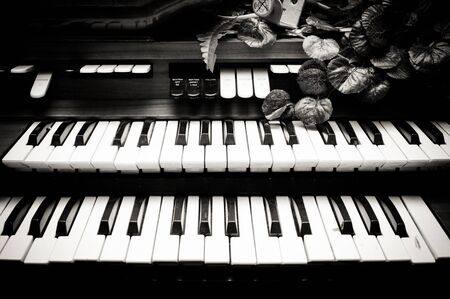 electronic piano: Electronic piano double keyboards vintage black and white Stock Photo