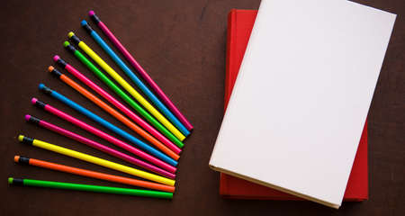 withe: Wooden writer desktop with colorful pencil and withe empty cover book