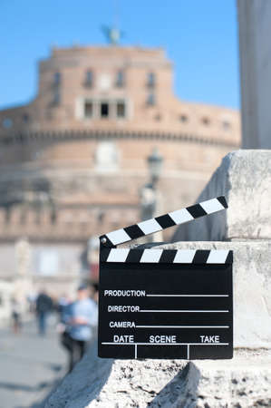 angelo: Movie clapper board with Castel Sant Angelo view out of focus in background
