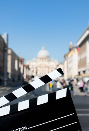 st  peter: Movie clapper board with St Peter cathedral view out of focus in background Stock Photo