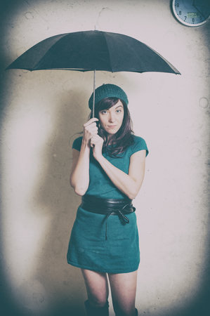 70s: Young woman in 70s style portrait with umbrella old vintage image effect Stock Photo