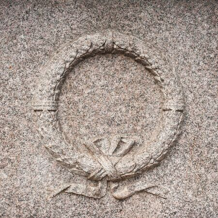 bass relief: Granite stone wreath bass relief symbol of memory monument detail