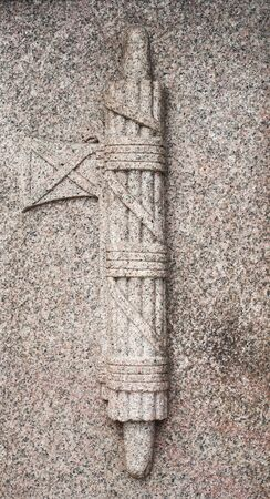 bass relief: Granite stone fascist symbol bass relief of memory monument detail
