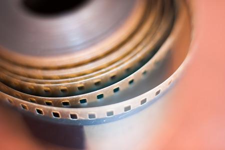 macro film: Movie symbol: detail of 35 mm film reel perforations, macro close up selective focus