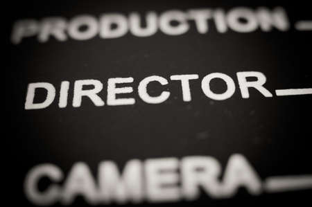 board of director: Detail of movie clapper board with director label, macro close up selective focus black and white Stock Photo