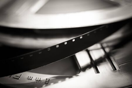 super 8: Movie symbol: detail of super 8 mm film reel macro close up selective focus black and white Stock Photo