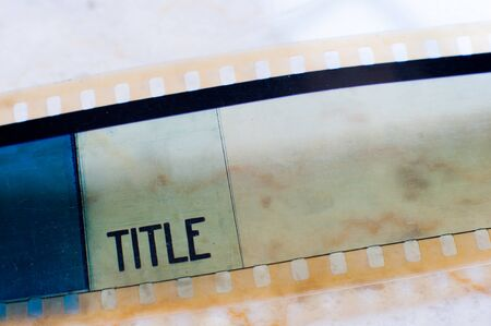 macro film: Detail of 35 mm film with title label printed on frame macro close up selective focus