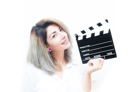 audition: Young blue eyes blonde woman actress audition with movie clapper Stock Photo
