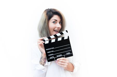 actress: Young blue eyes blonde woman actress audition with movie clapper Stock Photo