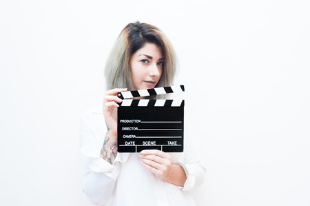 actress: Young blue eyes blonde woman actress audition with movie clapper on white background