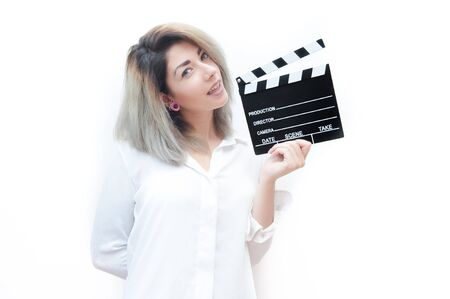 audition: Young blue eyes blonde woman actress audition with movie clapper on white background