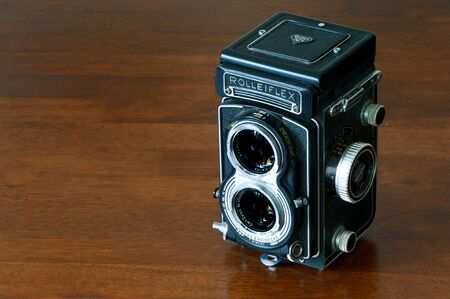 collectible: Vintage collectible bioptical Rolleiflex camera still life on wooden table