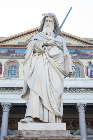 St Paul holding a sword statue outside basilica in Rome, Italy Stock Photo