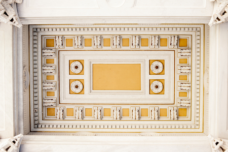 yellow ochre: Classic old ceiling decoration flowers design, white and ochre with copy space