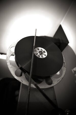 35mm: Black and white cinema 35mm professional projector, reel detail Stock Photo