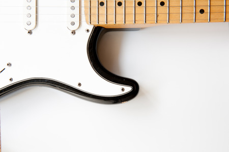 musical instrument parts: Horizontal electric guitar body part close up with body  and neck on white background Stock Photo