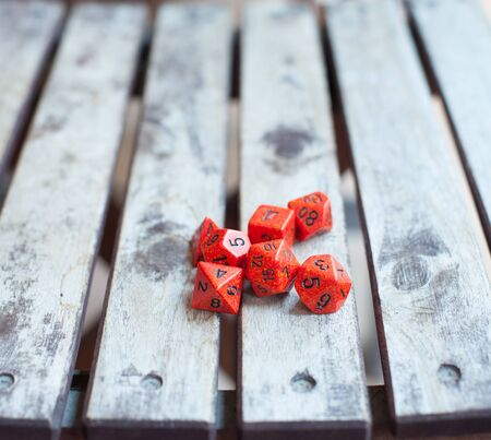 role play: Group of different red role play baord game dice close up on wooden table
