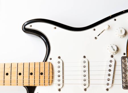 musical instrument parts: Horizontal electric guitar body part close up with body  knobs and neck on white background